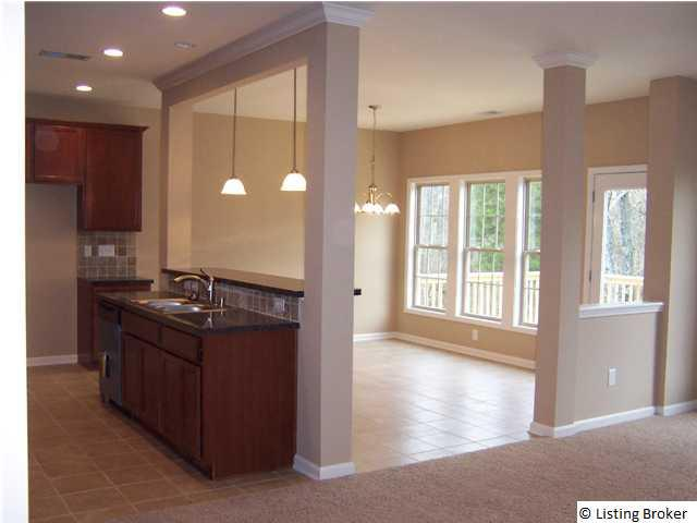 To The Open Living Room Kitchen With A Corner Pantry And Island Raised Breakfast Bar Large Eat In Area